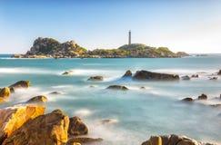 Ke Ga Lighthouse sunset with smoother surf Stock Photos