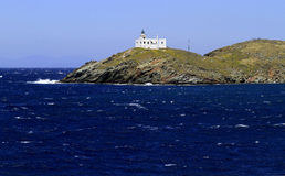 Kea Island in Greece. White church on the hill along the coastline of Kea Island, in Cyclades complex of the Mediterranean Sea, Greece Royalty Free Stock Photography
