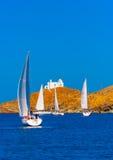 In Kea island in Greece. Sailing boats during a regatta in Aegean sea near Kea island Greece Royalty Free Stock Photo