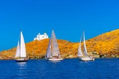 In Kea island in Greece. Sailing boats during a regatta in Aegean sea near Kea island Greece Stock Photos