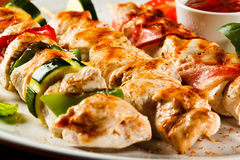 Kebab. Grilled poultry meat and vegetables stock images