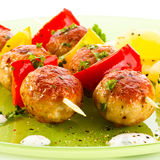 Kebab. Grilled meatballs with fruits and vegetables stock photography