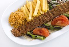 Kebab. Serve with pepper, tomato and onion on white plate.Visit my portfolio for other food products image Royalty Free Stock Images