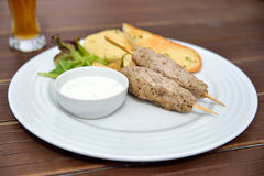 Kebab. And beer with grilled vegetables, baguette and yogurt dip Stock Photography