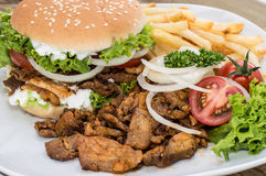 Kebab Burger with Chips on wood Stock Photo