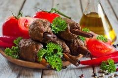 Kebab on cinnamon sticks Stock Photo