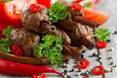 Kebab on cinnamon sticks Royalty Free Stock Images