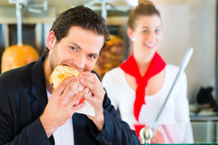 Kebab - customer and hot Doner with fresh ingredients Stock Photos