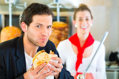 Kebab - customer and hot Doner with fresh ingredients Stock Photography