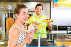 Kebab - customer and hot Doner with fresh ingredients Royalty Free Stock Photography