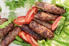 Kebab de Lula del cordero con las verduras Foto de archivo libre de regalías