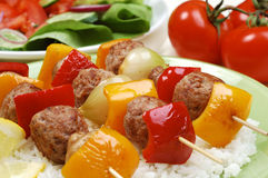 Kebab dinner. Grilled meat, rice and vegetables royalty free stock image