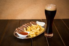 Kebab with french fries and beer Royalty Free Stock Photo