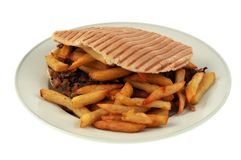 Kebab with french fries in close-up stock photo