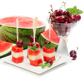 Kebab fruit on stick   with melon, cherry and water melon Stock Photos