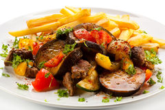 Kebab. Grilled meat, French fries and vegetables royalty free stock photography