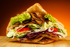 Kebab. Grilled meat and vegetables Stock Image