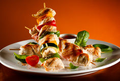 Kebab. Grilled poultry meat and vegetables royalty free stock images