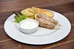 Kebab. With grilled vegetables, baguette and yogurt dip Stock Image