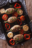 Kebab with grilled vegetables on the grill pan close-up. vertica Royalty Free Stock Image