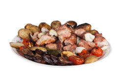Kebab and grilled vegetables on a plate isolated on white backgr Royalty Free Stock Image