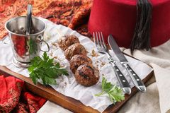 Kebab with herbs, spices and sauce on a serving board royalty free stock photography