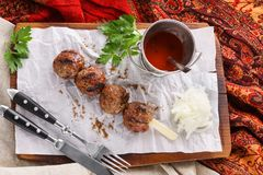 Kebab with herbs, spices and sauce on a wooden board royalty free stock photos