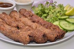 Kebab indiani pakistani di Seekh di cucina Immagini Stock Libere da Diritti