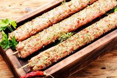 Kebab of lamb with herbs. Raw turkish traditional dish meat kebab with herbs and spices.Caucasian kitchen Stock Image