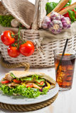 Kebab made of fresh vegetables and served with cold cola Stock Photography