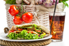 Kebab made of vegetables and meat served with cold cola Royalty Free Stock Images