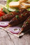 Kebab meat with vegetables on an old table Stock Image