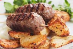 Kebab, minced meat skewer. Grilled kebab, turkish minced meat skewer with roasted potato Stock Images