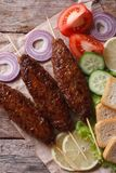 Kebab of minced meat with vegetables vertical top view Royalty Free Stock Photo