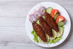 Kebab of minced meat on wooden skewers,  top view Royalty Free Stock Photography