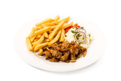 Kebab plate with french fries Stock Photos