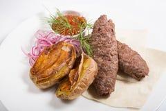 Kebab with potato garnish Royalty Free Stock Image