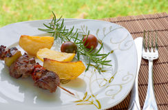 Kebab with potatoes and cherry tomatoes Stock Images