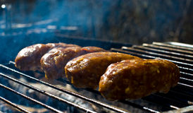 Kebab rolls on grill Royalty Free Stock Photography