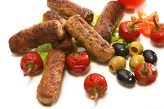 Kebab rolls olives and pepper over white Royalty Free Stock Photo