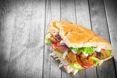 Kebab Sandwich on Wooden Table with Copy Space Stock Photography