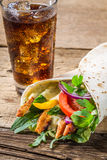 Kebab served with cold cola stock images