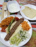 Kebab served in the plate with yogurt salad. Stock Photography