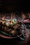 Kebab. Shish kebab skewers on the wooden table Royalty Free Stock Photography