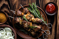 Kebab. Shish kebab skewers on the wooden table Stock Images