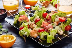 Kebab on skewers with meat and veggies stock images