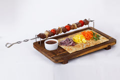 Kebab skewers of meat on a stick board Royalty Free Stock Images