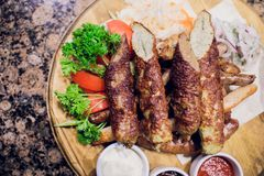Kebab. Traditional middle eastern, arabic or mediterranean meat kebab with vegetables and herbs. Overhead view, copy royalty free stock images