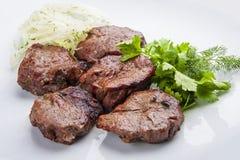 Kebab van varkensvleeshaasbiefstuk met ui stock fotografie