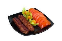 Kebab with vegetable garnish Stock Images